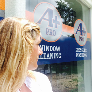 Sheila with her A+ Pro Windows Sign!